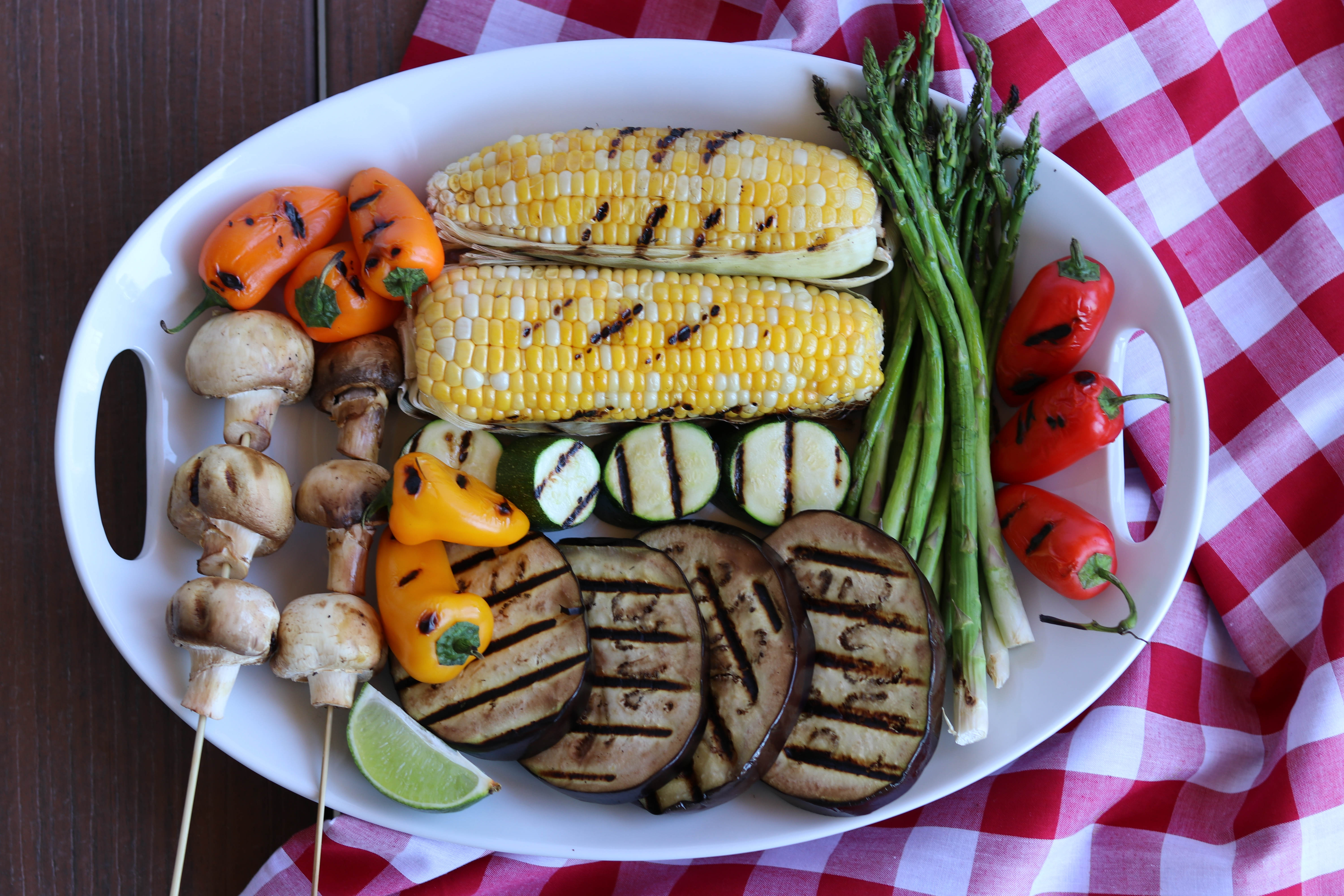 Image of grilled corn, mushrooms, and more vegetables.