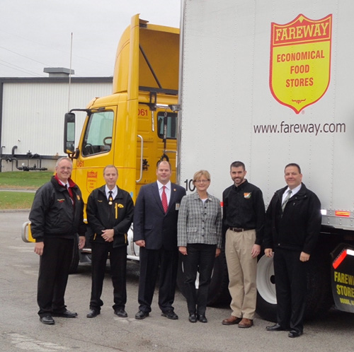 Fareway staff pose with Fareway delivery truck