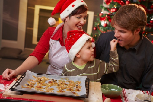 Image of a family baking Christmas cookies.