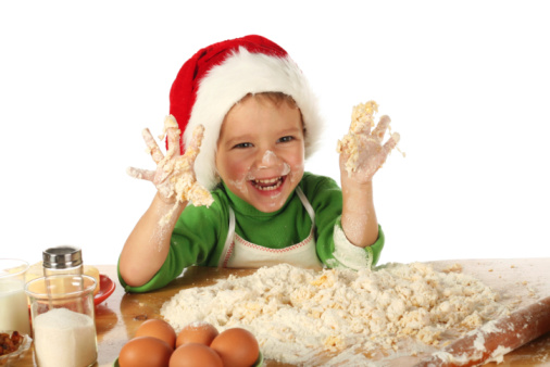 Image of a child helping bake Christmas treats.