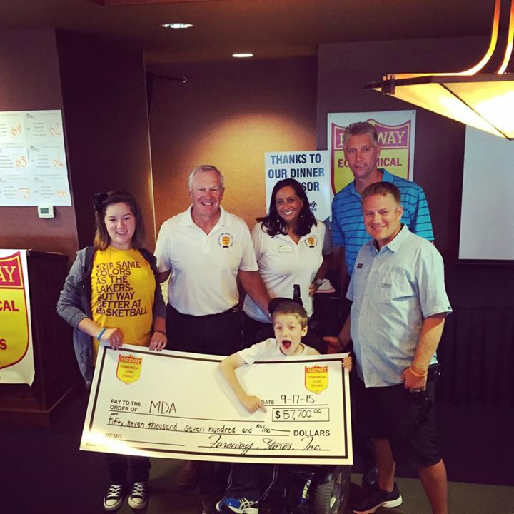 Fareway presents a check for $57,700 for MDA to fund research, provide health care services and support MDA families