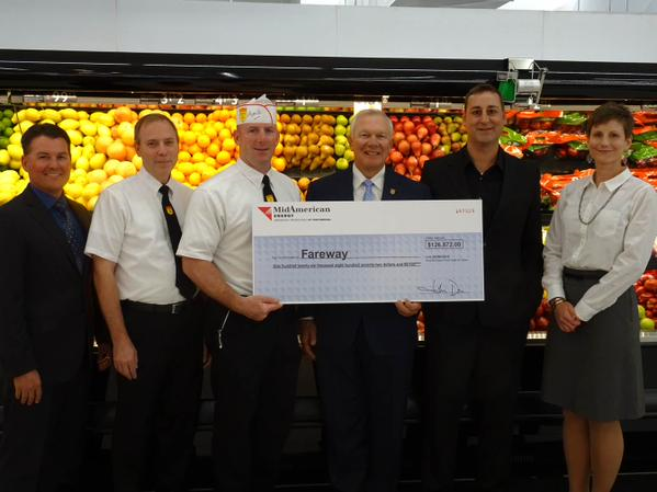 MidAmerican Energy Company presents check to West Des Moines Fareway Store employees.