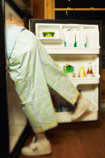Image of a person searching their fridge.