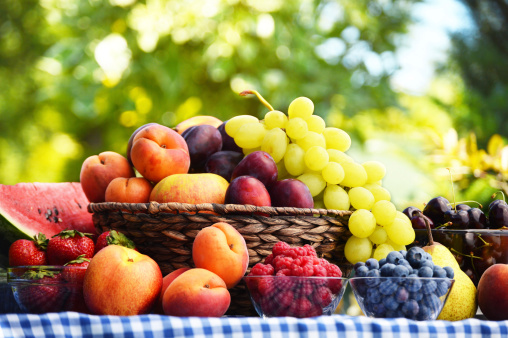 Delicious fruit on a picnic table